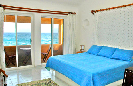 Master bedroom looking out to the bright blue Caribbean Sea