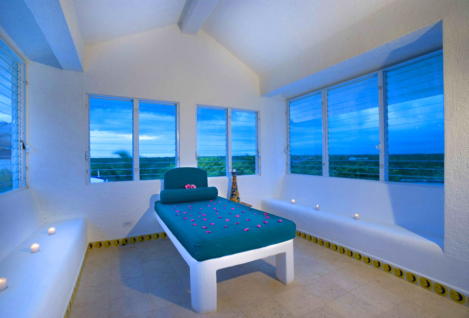 Huge windows looking out to an incredible view from your bedroom in Akumal