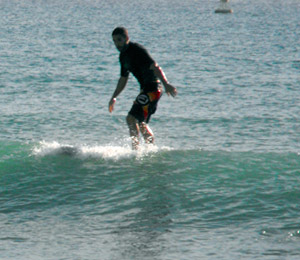 Surfs up! You may see a surfer or two catching some waves in Playa del Carmen