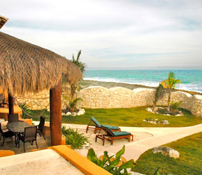 Sip your coffee under a Palapa overlooking the exquisite Akumal Bay